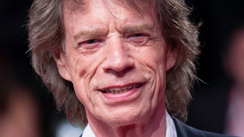 Mick Jagger on the red carpet smiling
