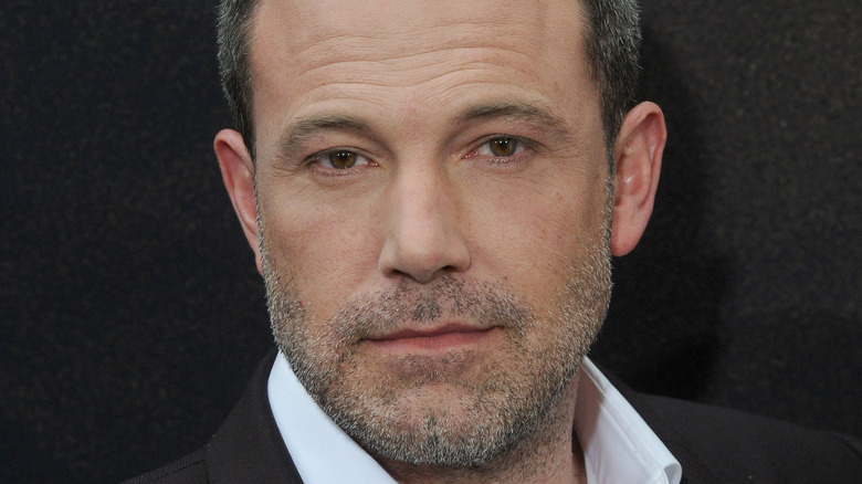 Ben Affleck poses in a brown suit.