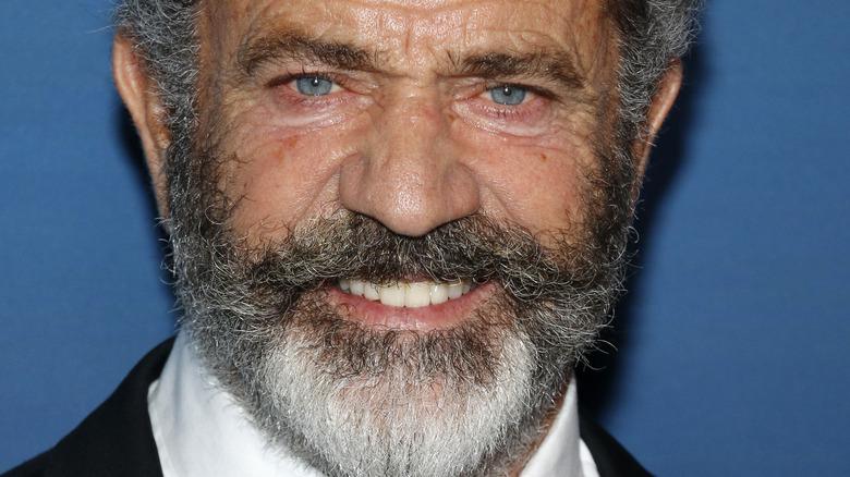 Mel Gibson with beard smiling at camera