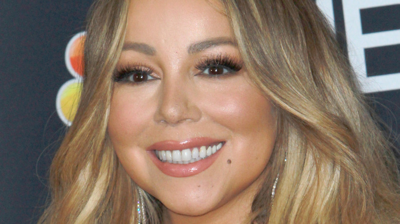 Mariah Carey smiles on the red carpet