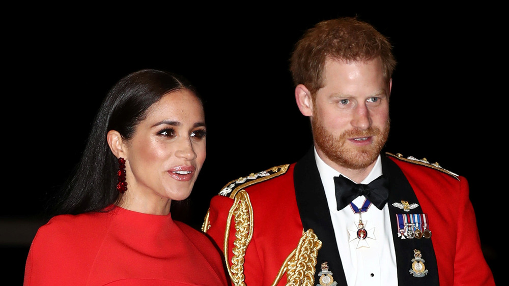 Prince Harry and Meghan Markle in red