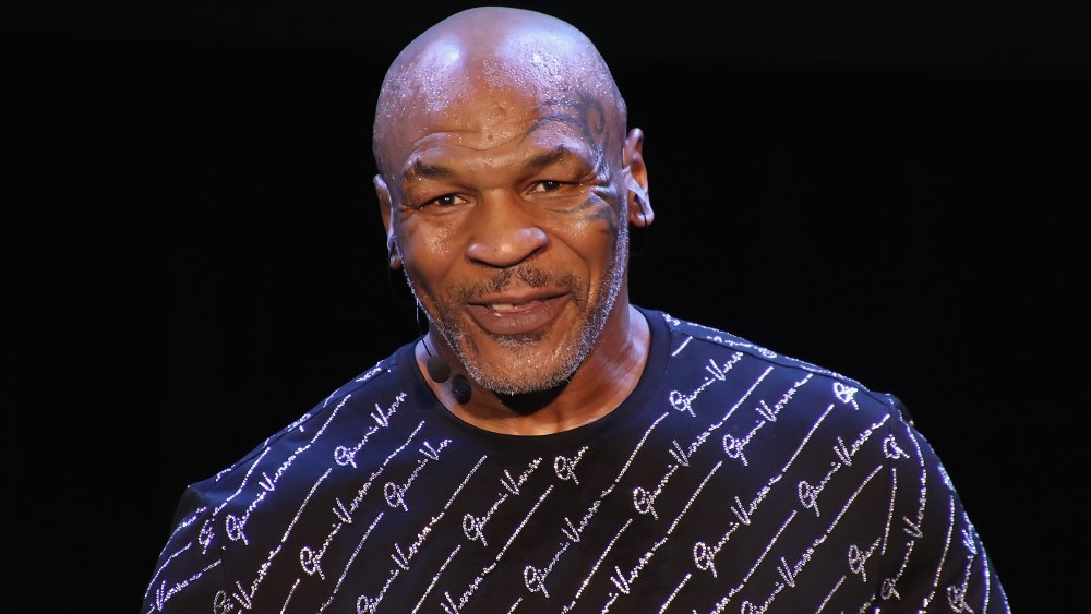 Mike Tyson on stage with microphone hooked to ear