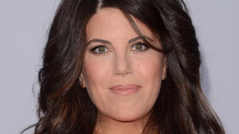 Monica Lewinsky gives a slight smile on the red carpet