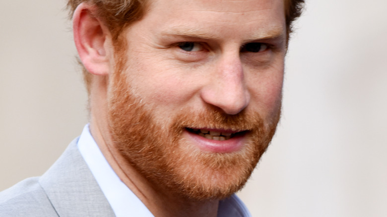 Prince Harry looking at the cameras