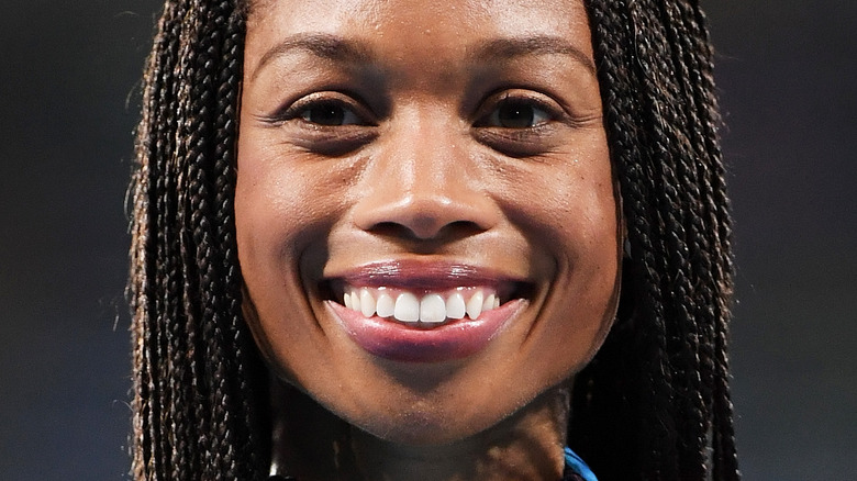 Allyson Felix, smiling, on the track field, 2021 photo