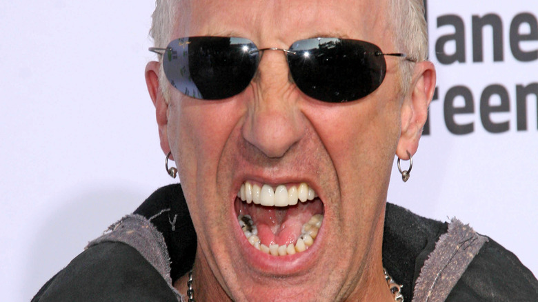Dee Snider at event yelling sunglasses