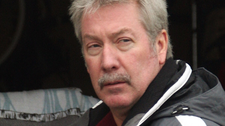 Drew Peterson in front of his garage