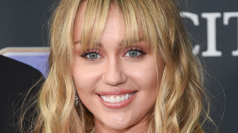 Miley Cyrus smiling on the red carpet