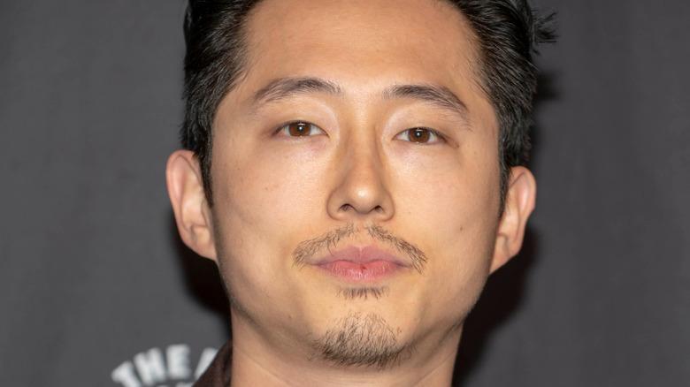 Steven Yeun posing