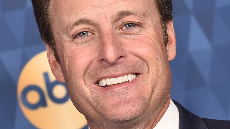 Chris Harrison smiling on the red carpet