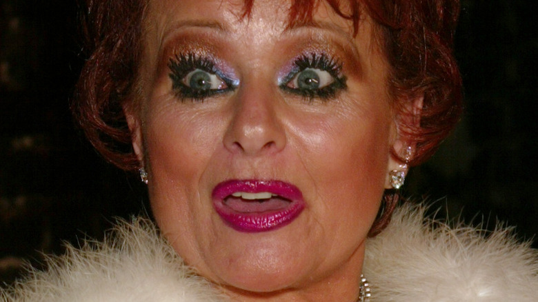 Tammy Faye Bakker with surprised expression and bright makeup in 2002