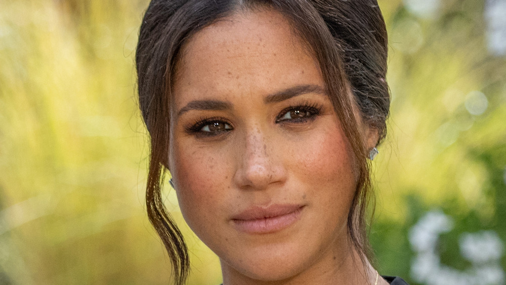 Meghan Markle appearing emotional during her interview with Oprah Winfrey