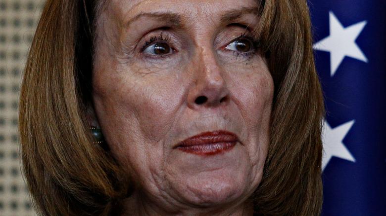 Nancy Pelosi looking away