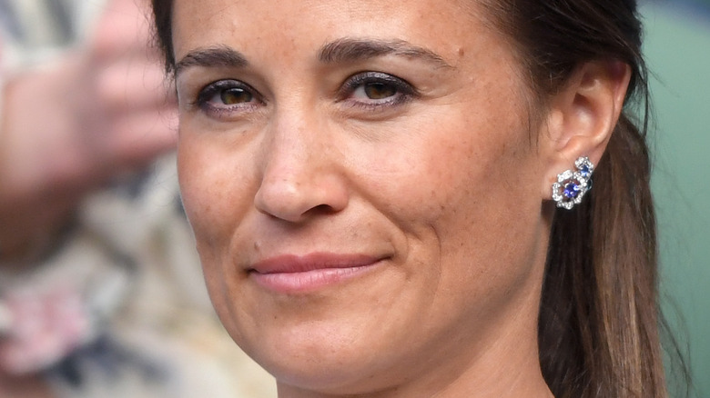 Pippa Middleton smiling with lips closed