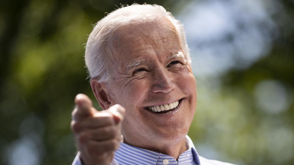 Joe Biden smiling and pointing