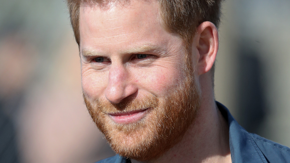 Prince Harry smiling outside