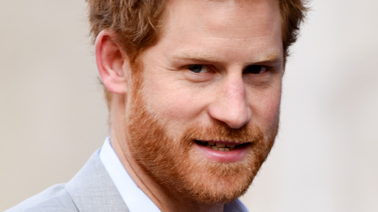 Prince Harry looking sideways at camera