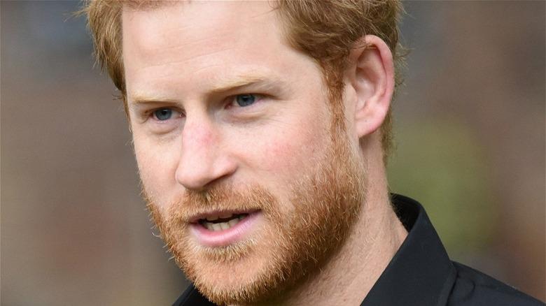 Prince Harry wearing black shirt