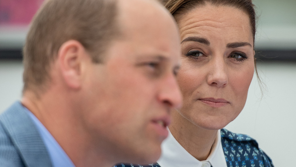 Prince William and Kate Middleton staring