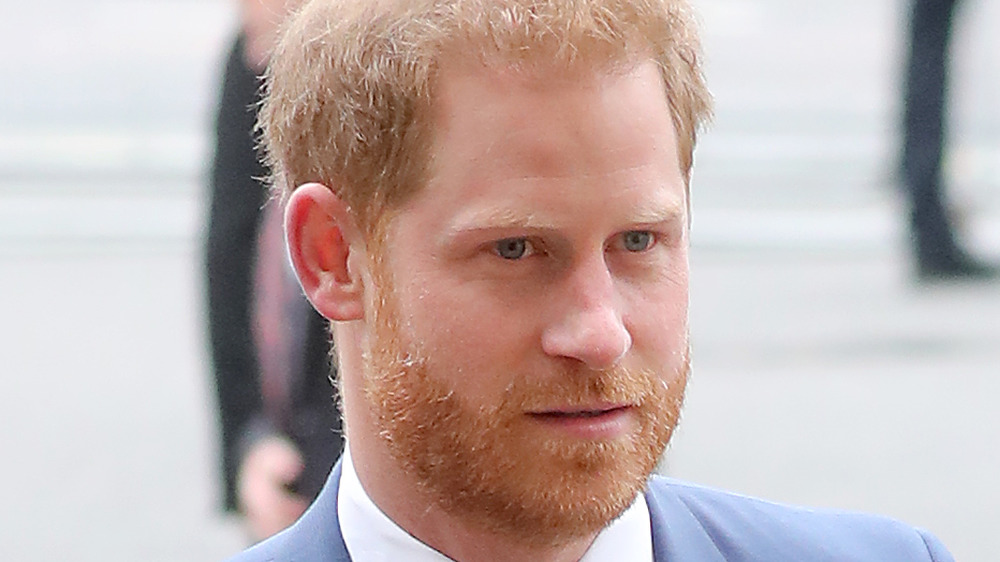 Prince Harry walking into an event
