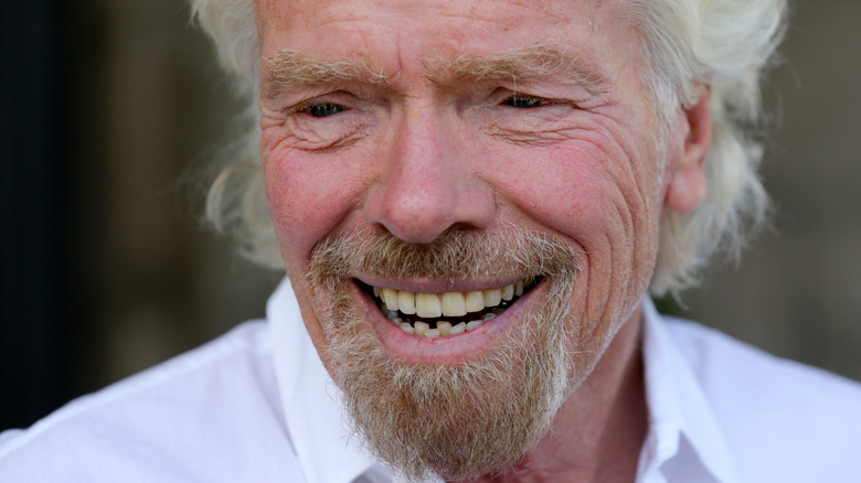 Richard Branson smiling and looking to the side