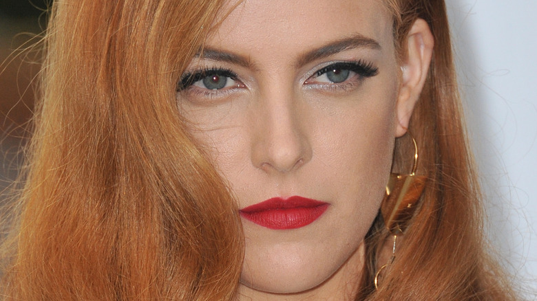Riley Keough with a neutral expression