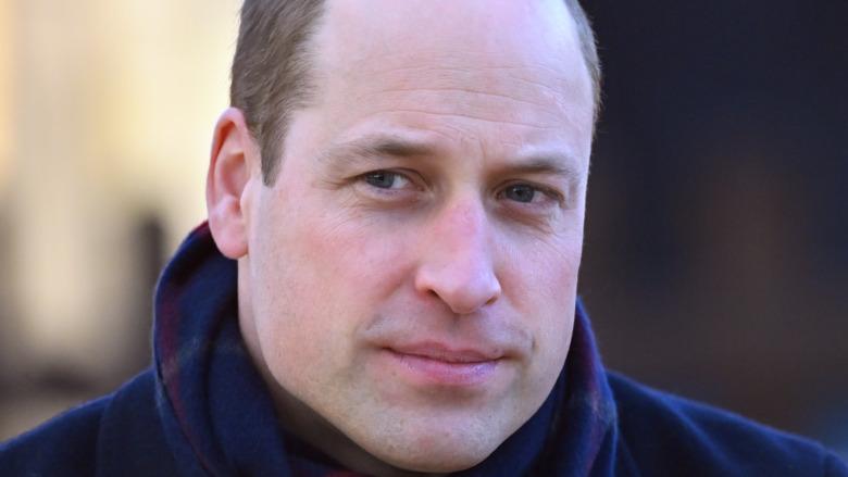Prince William smirks