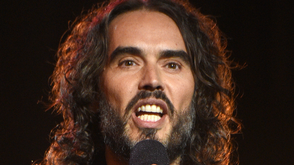 Russell Brand talking into microphone