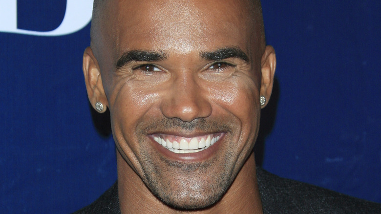 Shemar Moore smiles on red carpet
