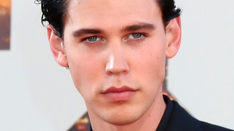 Austin Butler with a serious expression