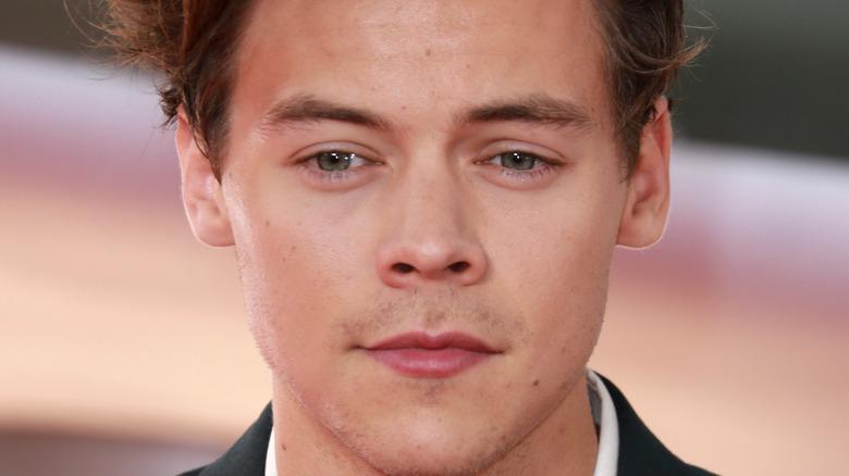 Harry Styles not smiling