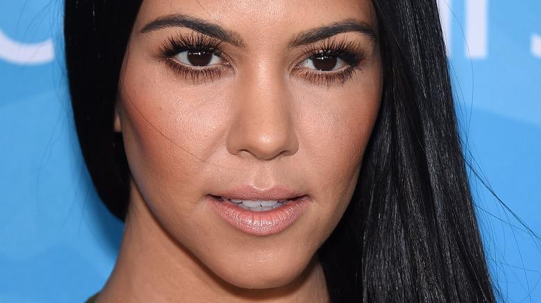 Kourtney Kardashian staring to the distance