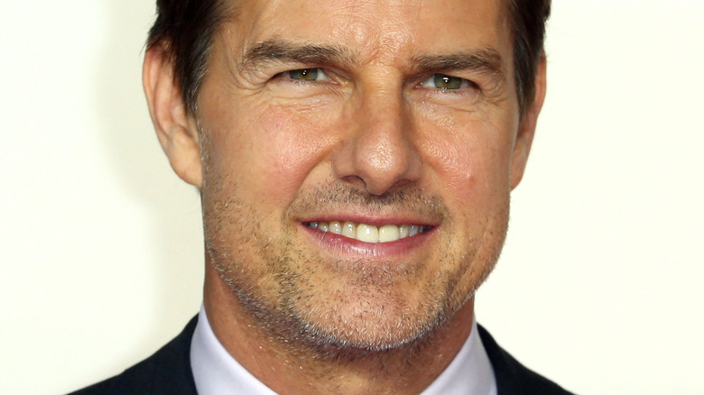 Tom Cruise smiling and squinting