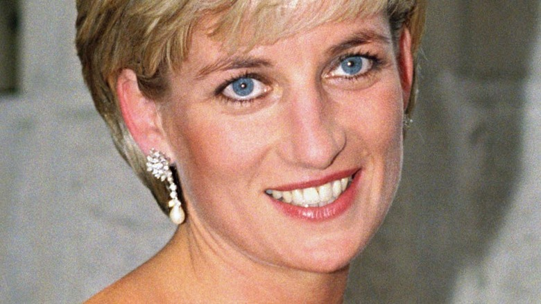 Princess Diana smiling with drop earrings