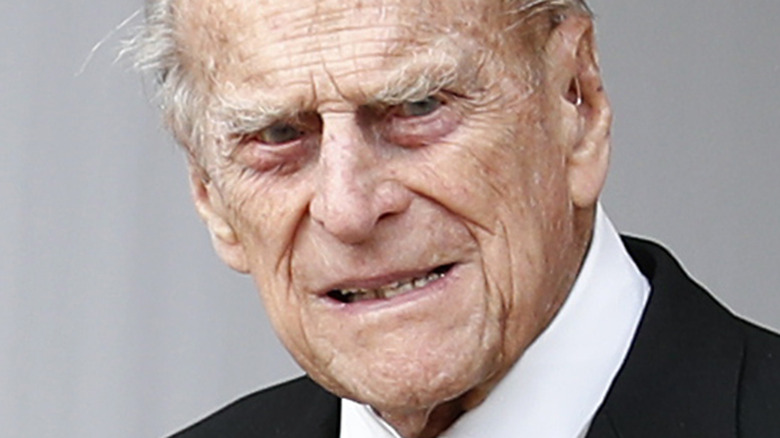 Prince Philip poses for a photo