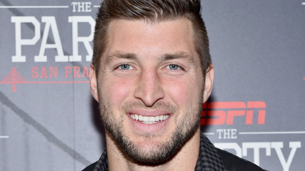 Tim Tebow smiling at an ESPN event