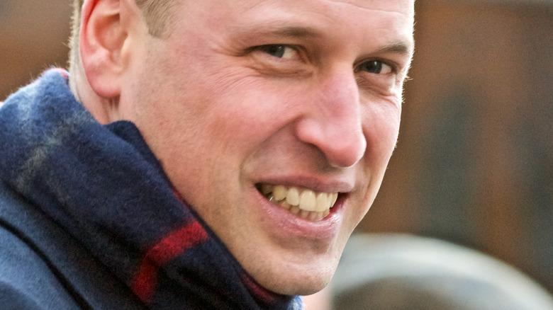 Prince William smiling at event