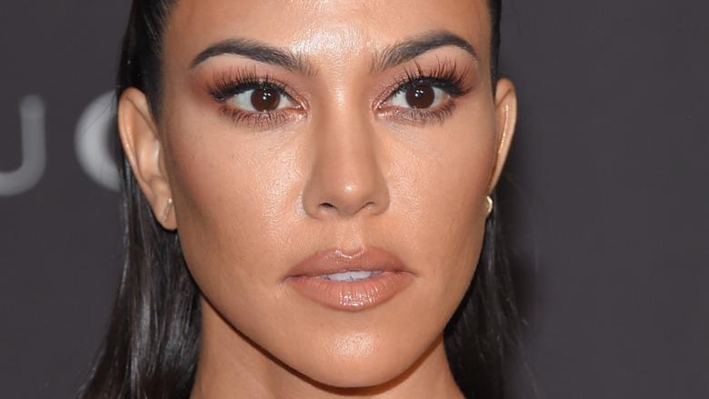 Kourtney Kardashian gives a menacing look on the red carpet