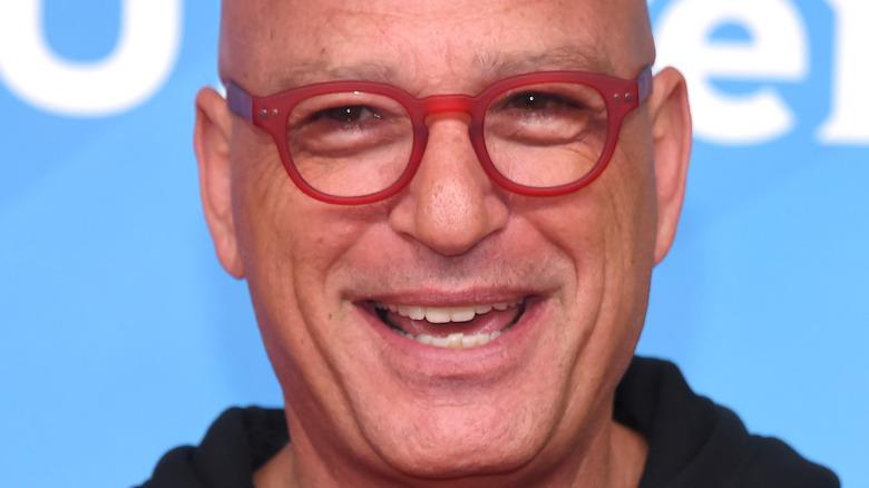 Howie Mandel smiling in glasses
