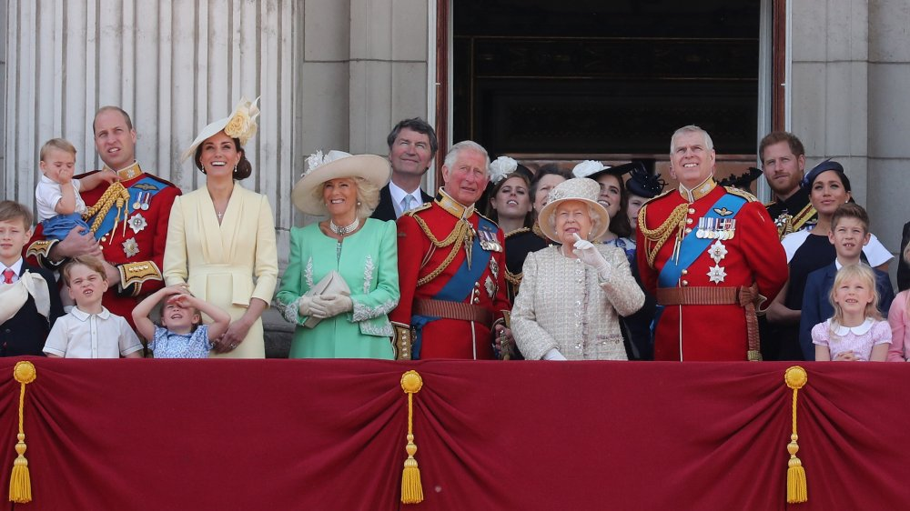The royal family watch a flypast from the balcony of Buckingham Palace during Trooping The Colour, the Queen's annual birthday parade in 2019