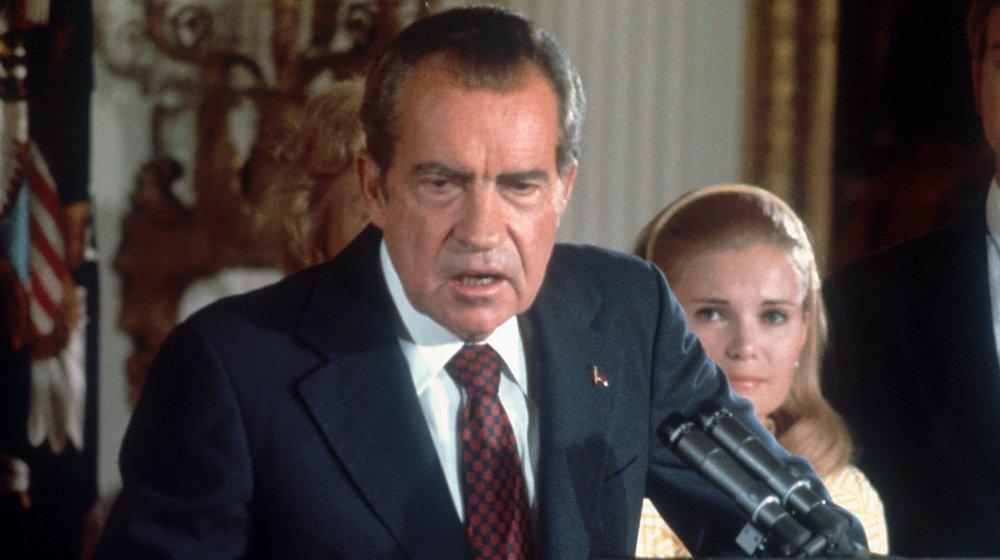 Richard Nixon speaking into microphone