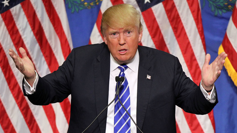 Donald Trump speaking with hands raised