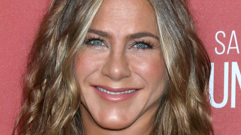 Jennifer Aniston looking at camera with wide smile