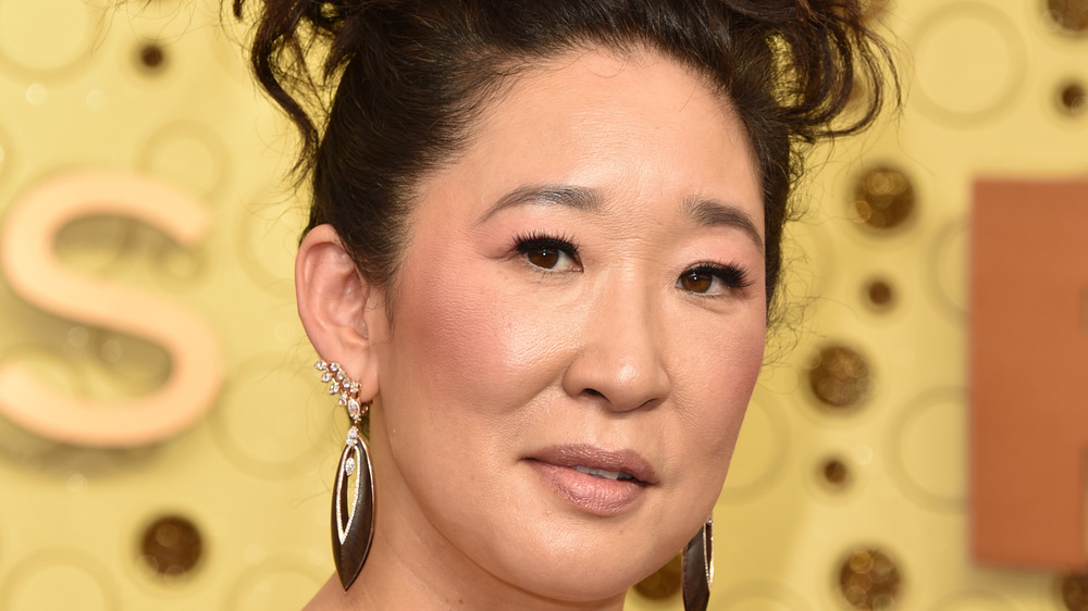 Sandra Oh posing at a red carpet event