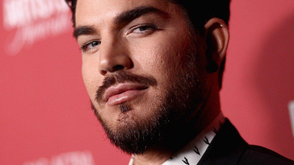 Adam Lambert gives the camera a smoldering look