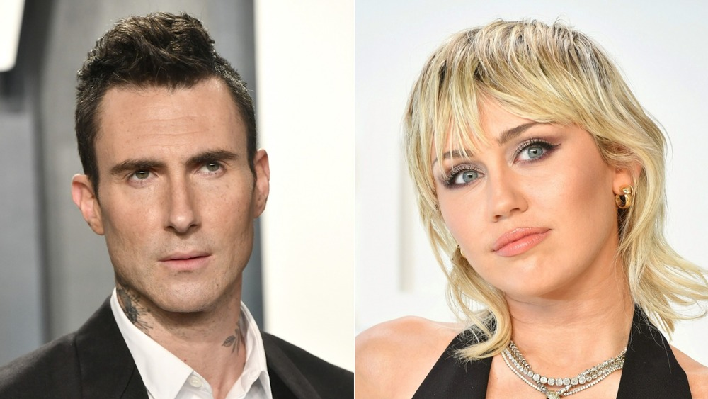 Adam Levine and Miley Cyrus on a red carpet