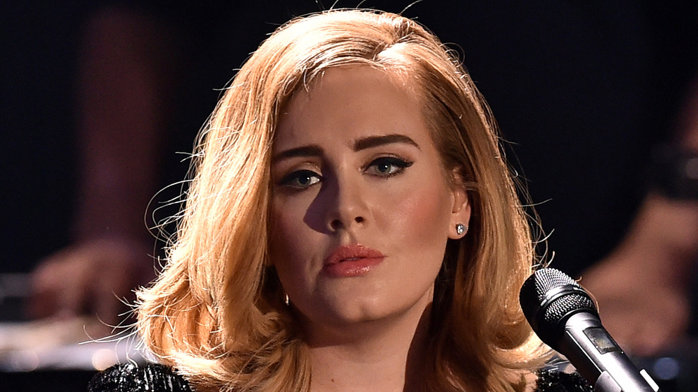 Adele staring with a serious expression