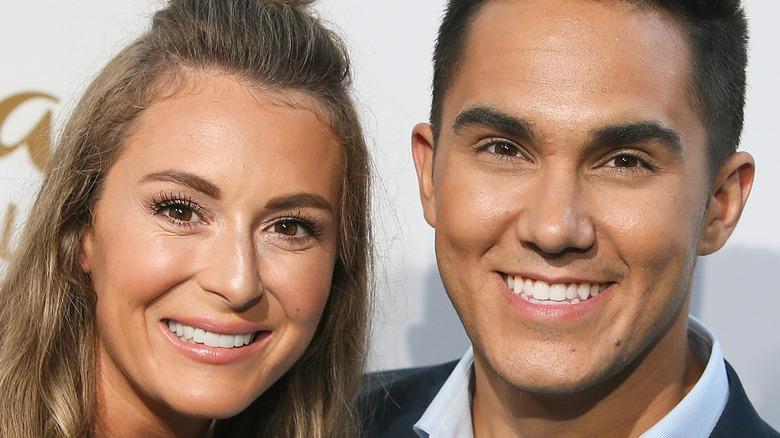 Alexa and Carlos smile at camera