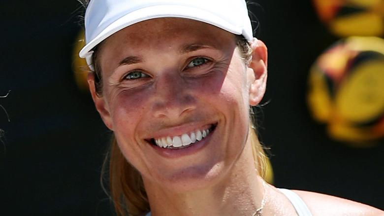 Alix Klineman smiling and wearing visor