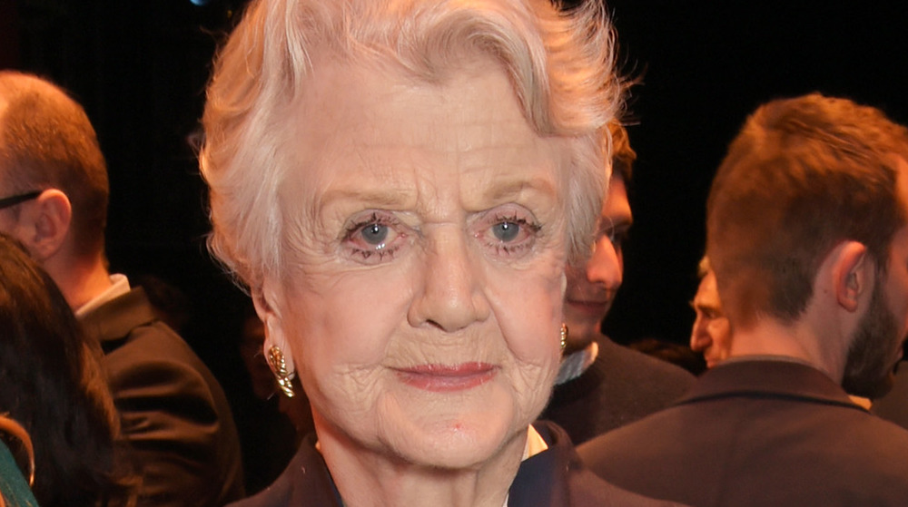 Angela Lansbury with a serious expression at an event